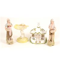 "Lot 2-A pair of Royal Dux figures - Fisher woman and man with baskets of fish, 16cm, a Royal Doulton dolphin and shell dish, 10cm, a Coalport cottage ""The Gate House"" (4)"