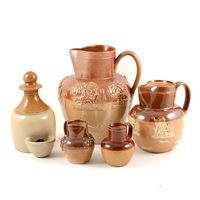 Lot 31-Doulton and other stoneware pottery, a Fulham Pottery 22cm salt glazed harvest jug, three Doulton harvest jugs 16cm,14.5cm and 9cm