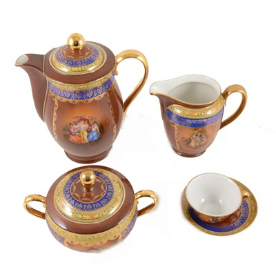 "Lot 2-A Slovakia coffee service in the ""Rembrandt"" design, burgundy ground with borders of blue and gilt, yellow floral."