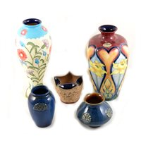 Lot 46-Jeanne McDougall for Old Tupton Ware, two tube lined floral flowers, heart and daffodil 26cm, spring flowers 28cm
