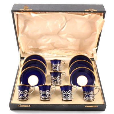 Lot 39-A set of six Aynsley bone china coffee cans and saucers, the cans with silver frames