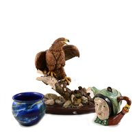 "Lot 15-A David Fryer sculpture ""Robin in a Boot"", resin model of an eagle, two character teapot, blue ceramic pot."