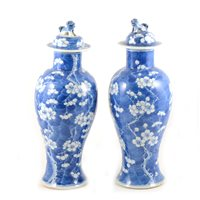 Lot 8-Pair of Chinese blue and white covered vases, bearing four character marks, baluster shape, with domed lids, decorated with blossom, 34cm.