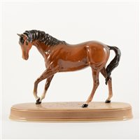 Lot 5-Beswick model of a chestnut horse, 19cm, with an oval stand, (2).