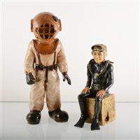 Lot 24-Two art pottery figures of Deep-sea Divers, by Christine Goldstone