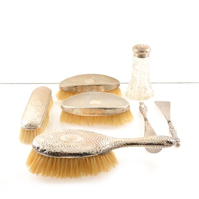 Lot 220-A silver topped glass dredger by John Grinsell & Sons, Birmingham 1907, a pair of dressing table silver backed brushes, London 1921, two more brushes, button hooks and shoe horns etc