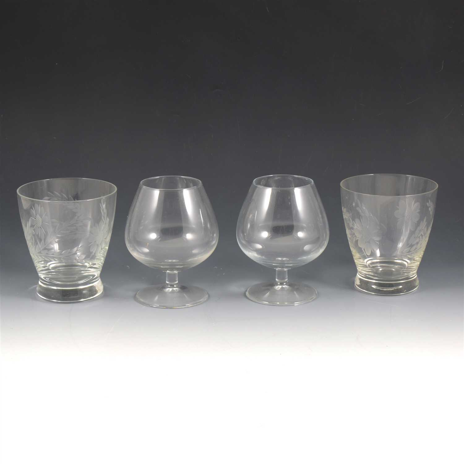 Lot 57-A quantity of etched and cut table glass, to include eight etched glass rinsers, a jug and set of six grape and vine etched squat goblets, six heavy goblets, six brandy balloons, six sherry glasses