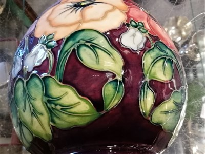 """Lot 40-A Moorcroft Pottery plate, """"Pansy"""" designed by Rachel Bishop, 1994, 25.8cm diameter, and two vases of the same design and date, 11cm and 19cm."""