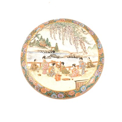 Lot 54-A Japanese satsuma circular covered dish, cover depicting women by waterside with wisteria above them, additional decorative scenes inside lid and dish, 12.5cm diameter.