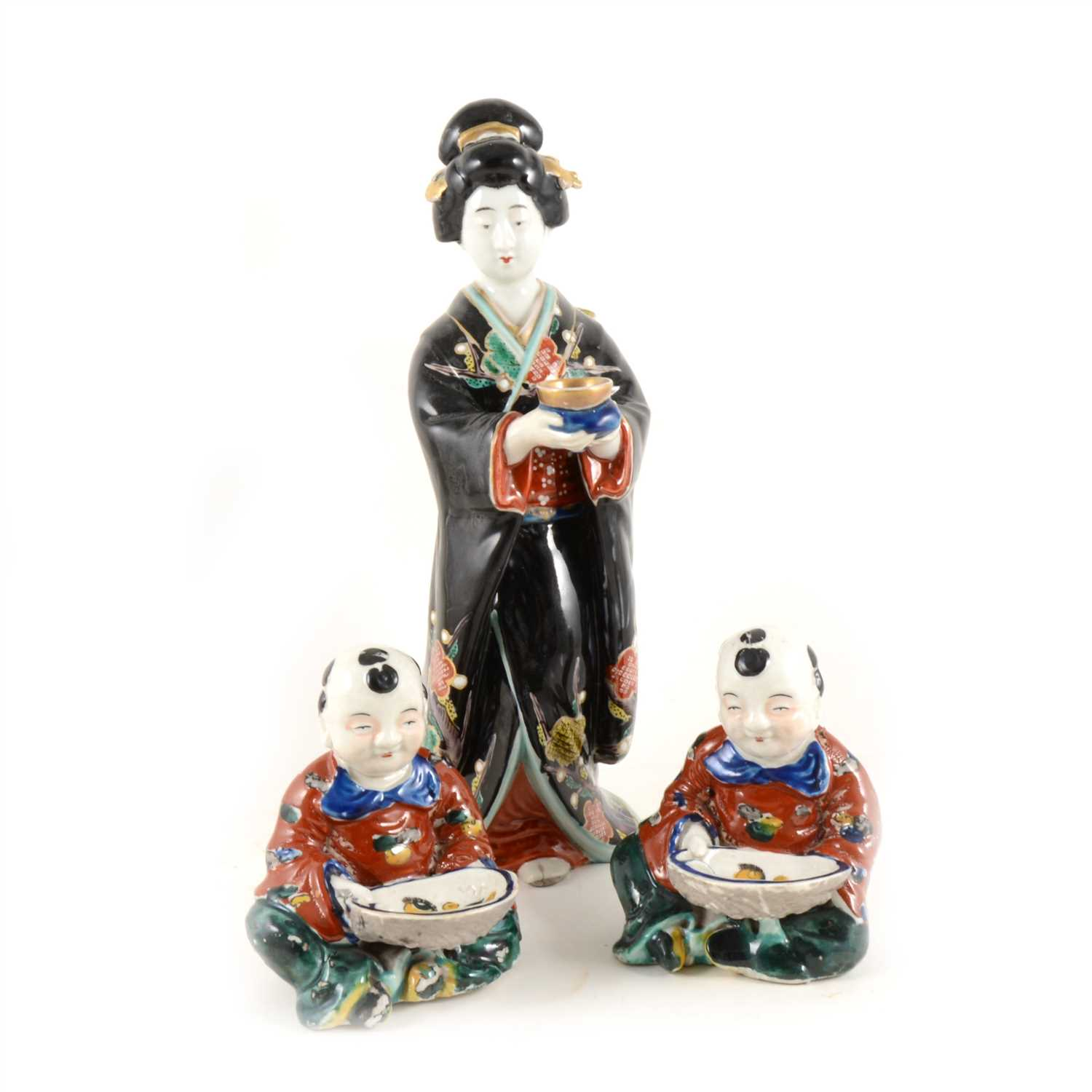 Lot 47-Three Japanese pottery figures.