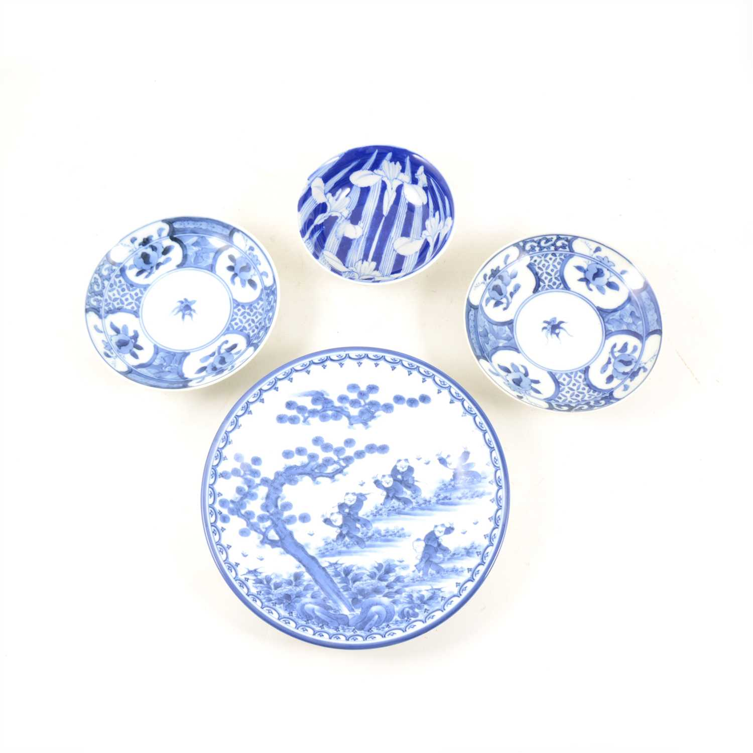Lot 52-A collection of Japanese blue and white plates and dishes, to include two with dragon design to centre, 21.8cm diameter, and a set of three with floral design, 14.8cm.