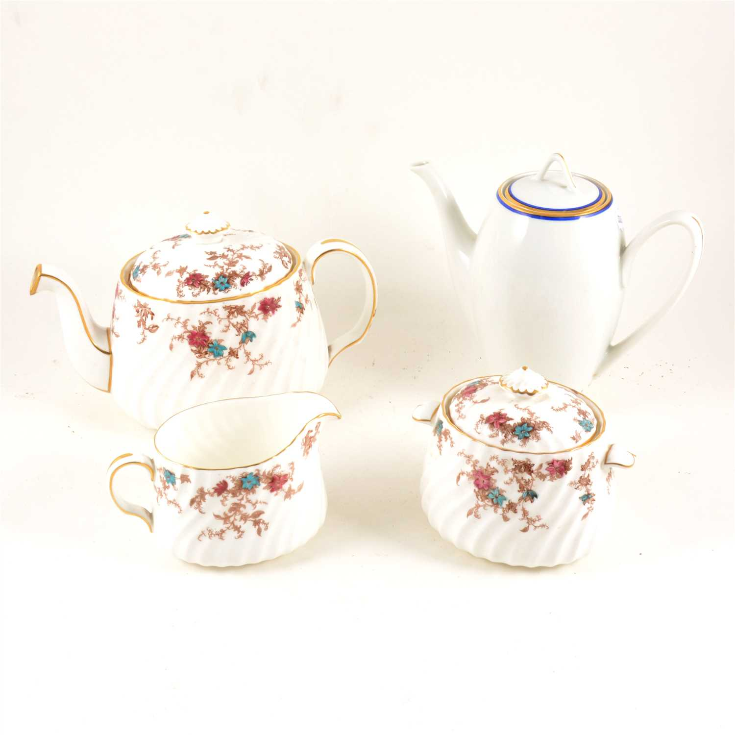Lot 60-Minton bone china part teaset, Ancestral pattern, and a Carlsbad coffee set.