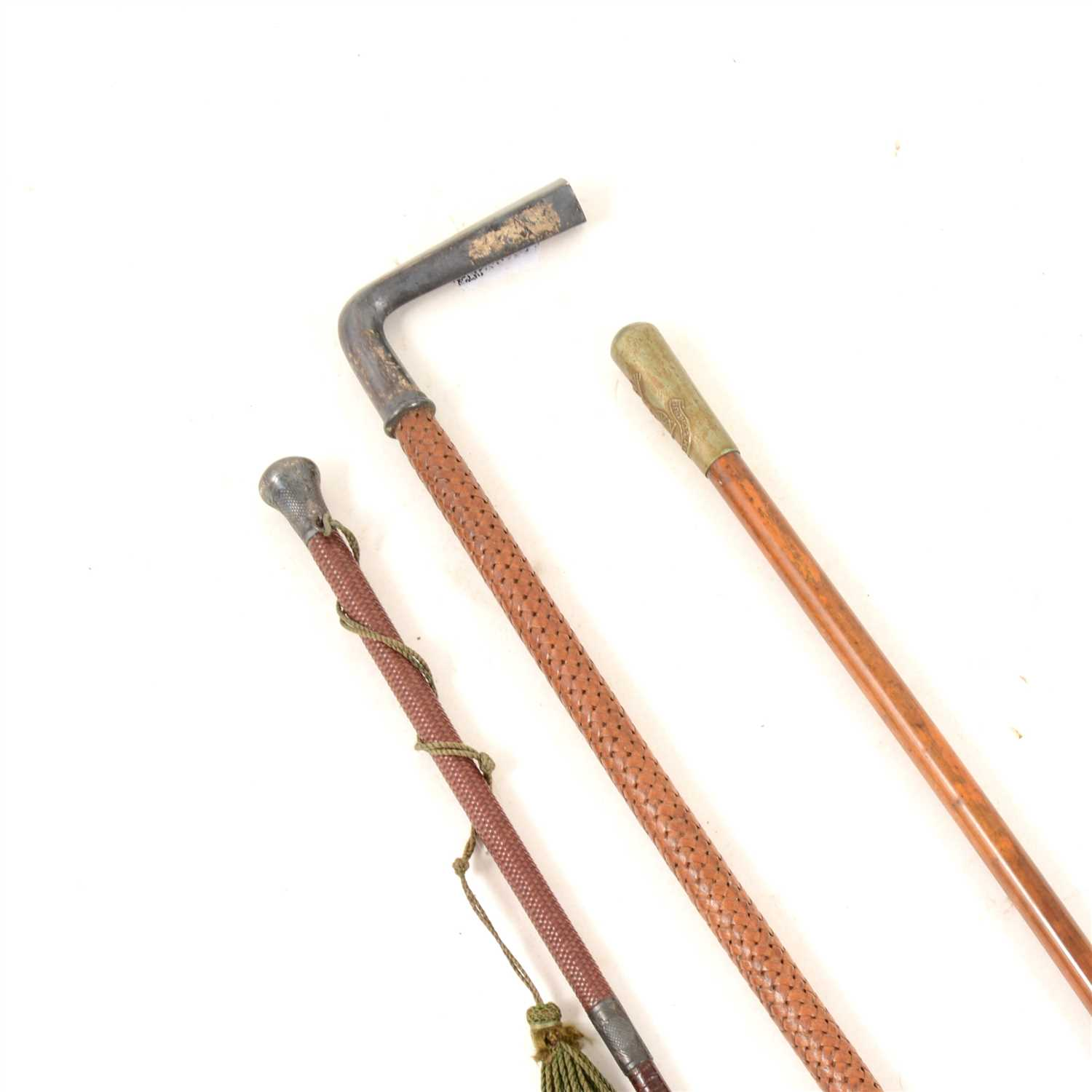 Lot 124-A swagger stick with metal pommel bearing the crest of O.T.C. Gresham School (Officers' Training Corps), overall 70cm