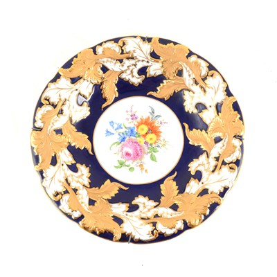 Lot 42-A Meissen hand painted dish with floral centre, cobalt blue border with gilded acanthus leaf decoration around scalloped rim, impressed C113,  30cm.