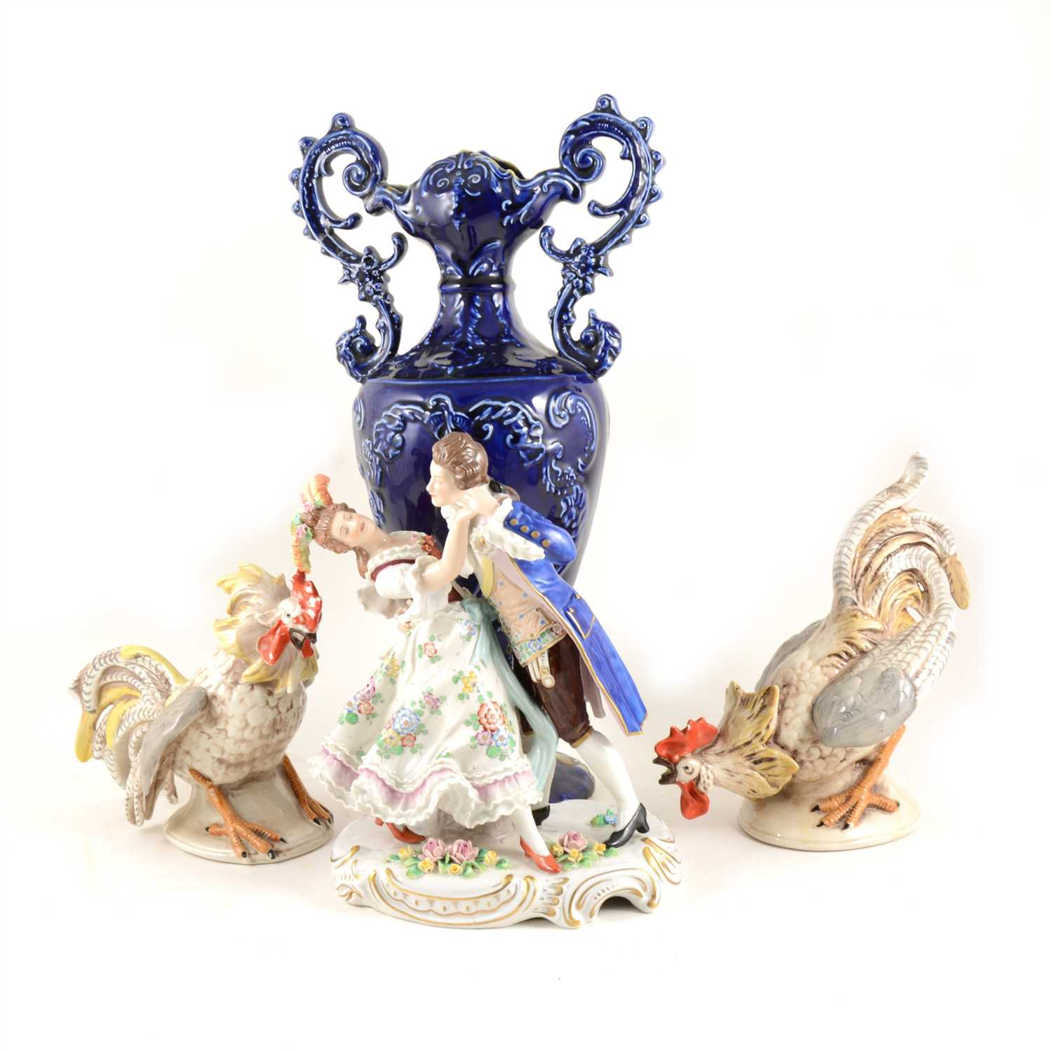 "Lot 32-A Capodimonte cockerel and another similar marked ""Made in GDR"", a Sitzendorf group of dancers"