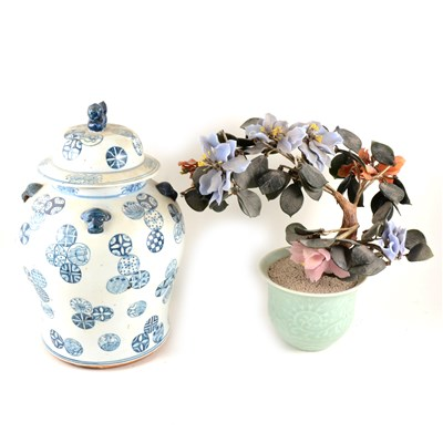 Lot 74-Chinese hard stone tree plant, celadon jardinière base, 35cm; and a Chinese blue and white covered jar. (2).