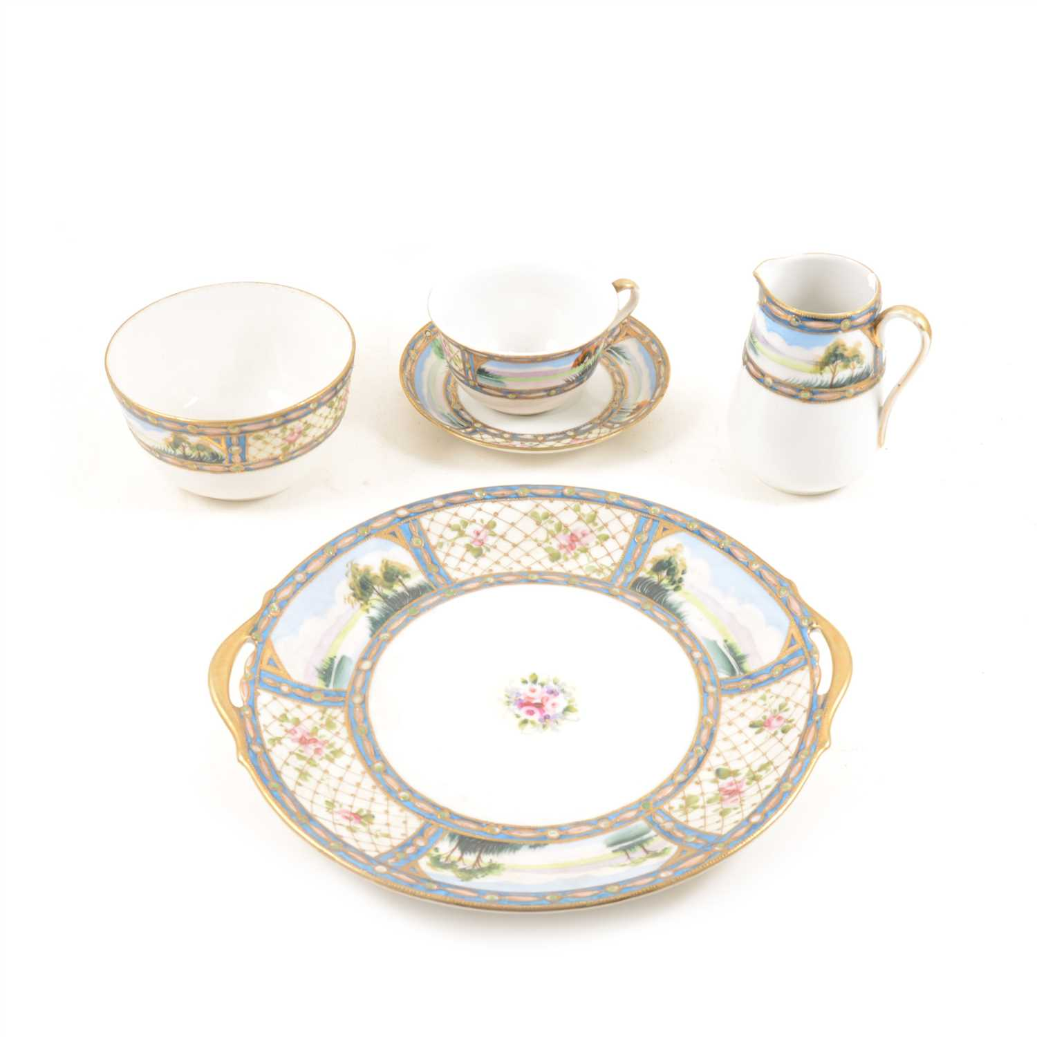 Lot 87-A Japanese Nippon hand painted tea service decorated with a floral lattice work border and lake scenes