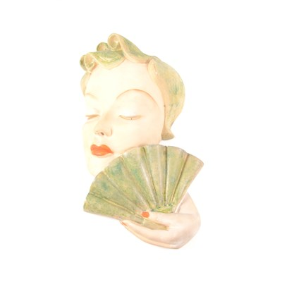 Lot 26-Art Deco painted plaster wall mask, signed Leonardi