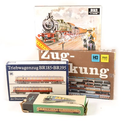Lot 32-Four HO gauge model railway sets by Piko
