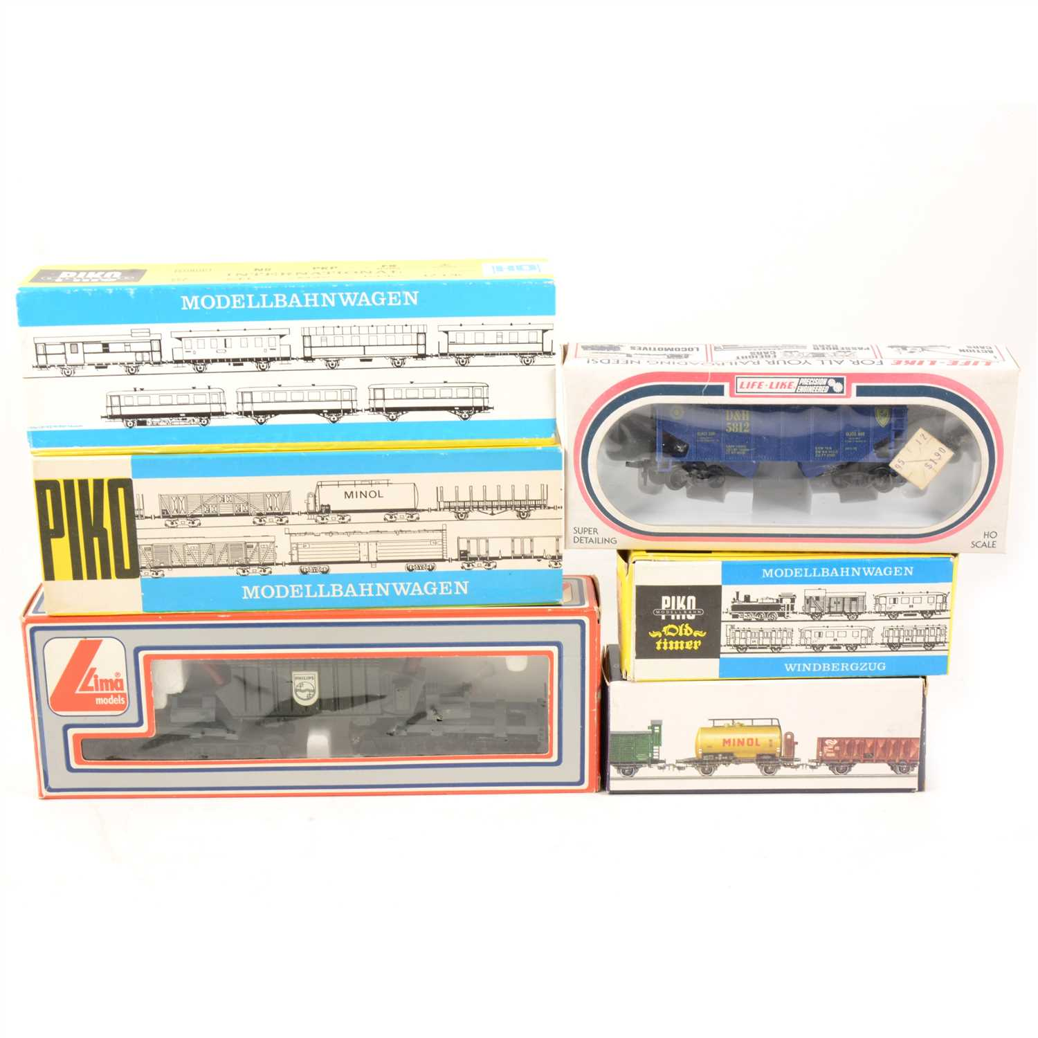 Lot 29-Thirty HO gauge model railway rolling stock, wagons, petrol tanks etc by Piko and others makers.