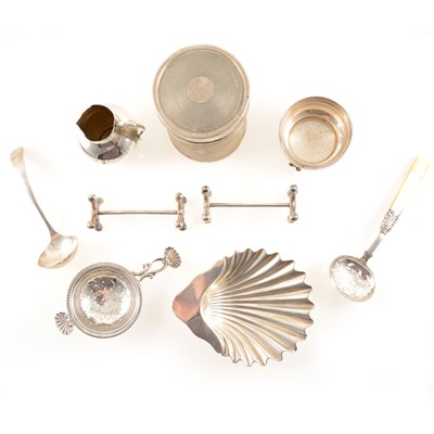 Lot 216-A selection of silver items, to include an engine-turned jar and lid by Mappin & Webb Ltd, Sheffield 1934, a small jug by George Unite & Sons, Birmingham 1890