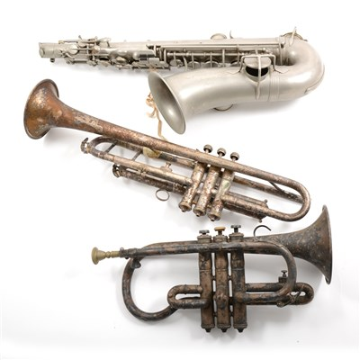 Lot 62-A trumpet, cornet, and alto saxophone, with various mutes.