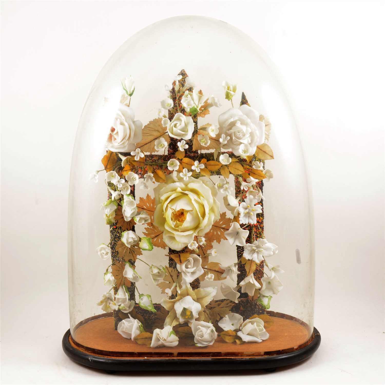 Lot 105-Porcelain head climbing rose arrangement, ...