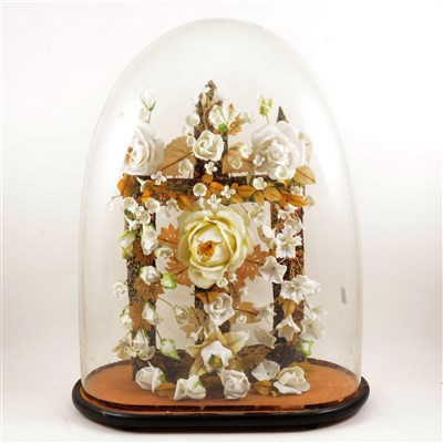 Lot 105-Porcelain head climbing rose arrangement, ...