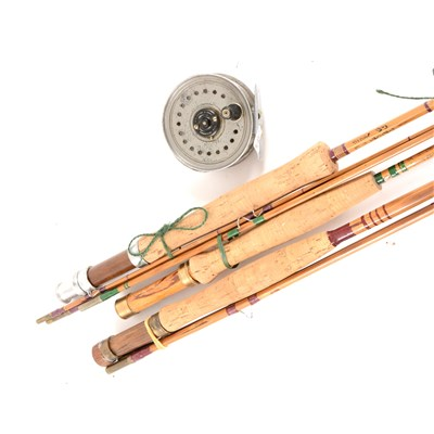 Lot 98-Fishing: A Beaudex 8cm fly reel; and three split cane rods