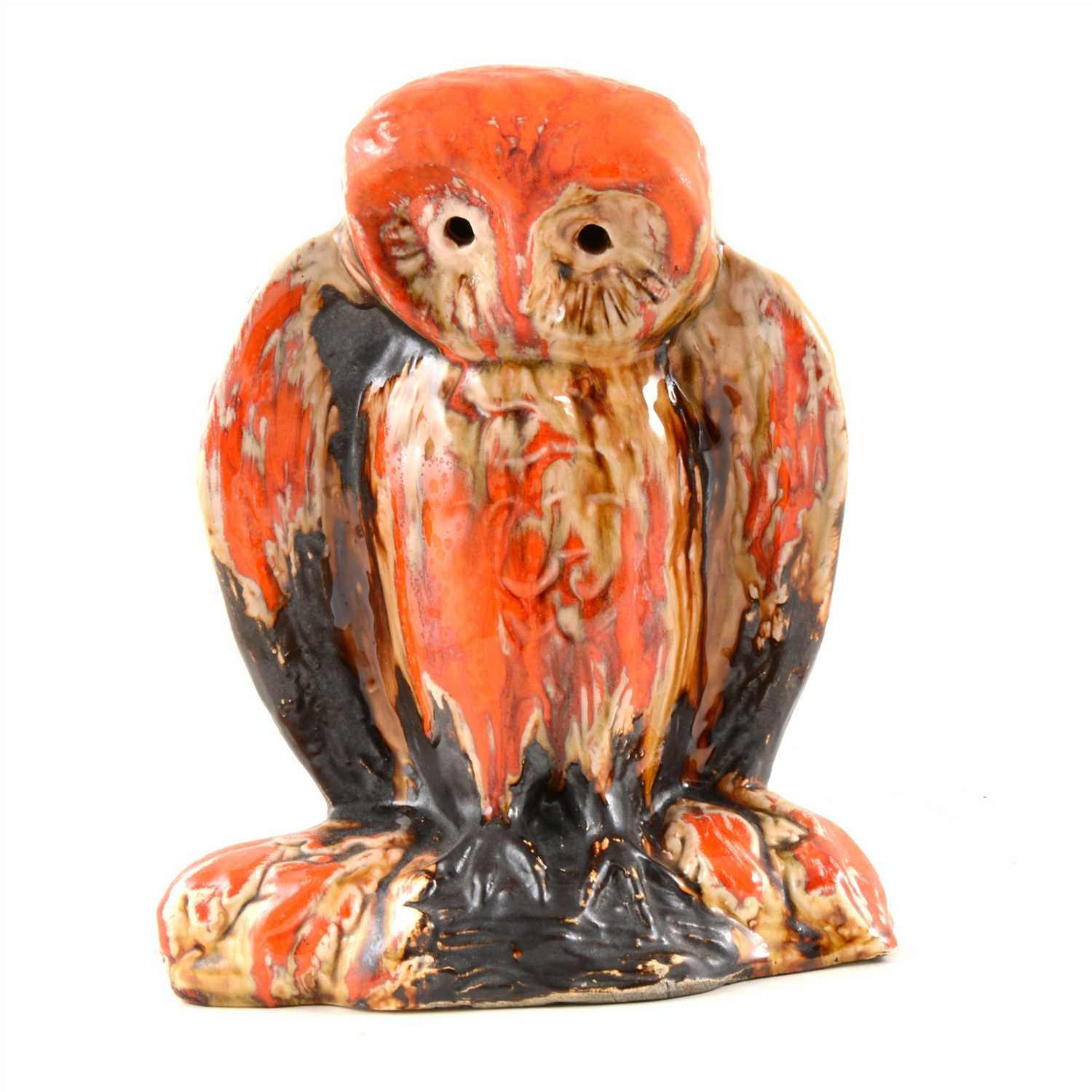 Lot 4-Eric Leaper, a large pottery model of an owl on a branch, running burnished orange glaze over a manganese body, 25.5cm high
