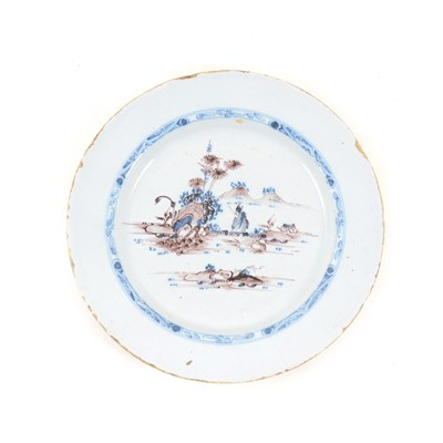 Lot 26-Dutch Delft plate, mid 18th Century, painted with a Chinese landscape, ...