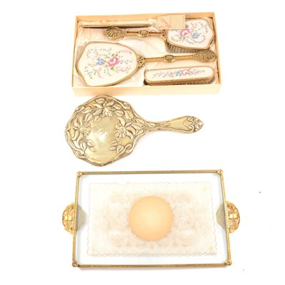 Lot 113-A boxed dressing table set by Rondis, comprising a hair brush, hand brush, comb, mirror with floral design and filigree handles, a matching tray, a hand mirror with fuchsia design, and a tapestry