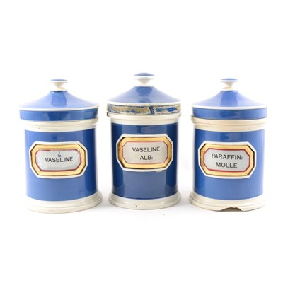 Lot 36-Three pottery drug jars and covers.