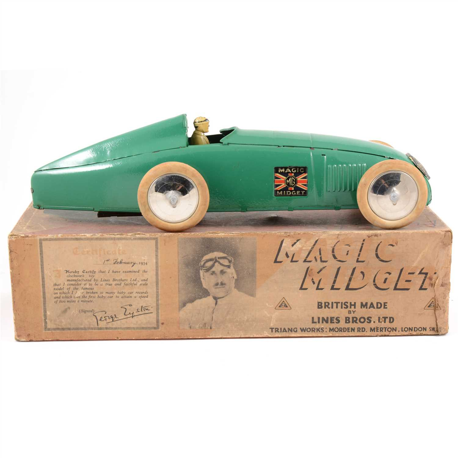 Lot 68-An impressive example of the Tri-ang Magic Midget record breaking car, boxed.