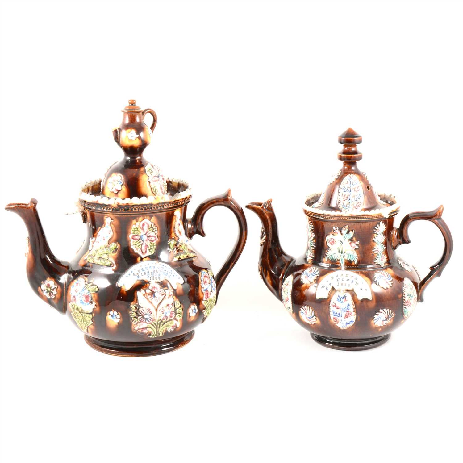 Lot 43-A Victorian bargeware teapot W. BARNES, GT. GLENN, 1882, and another similar.