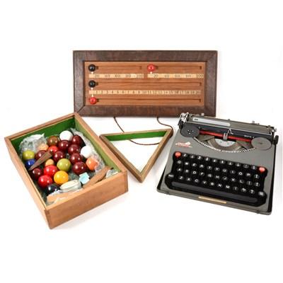 Lot 58-Baby Empire Deluxe portable typewriter, half-size snooker balls, etc
