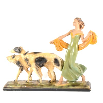Lot 87-An Art Deco painted plaster group, Lady with Borzoi