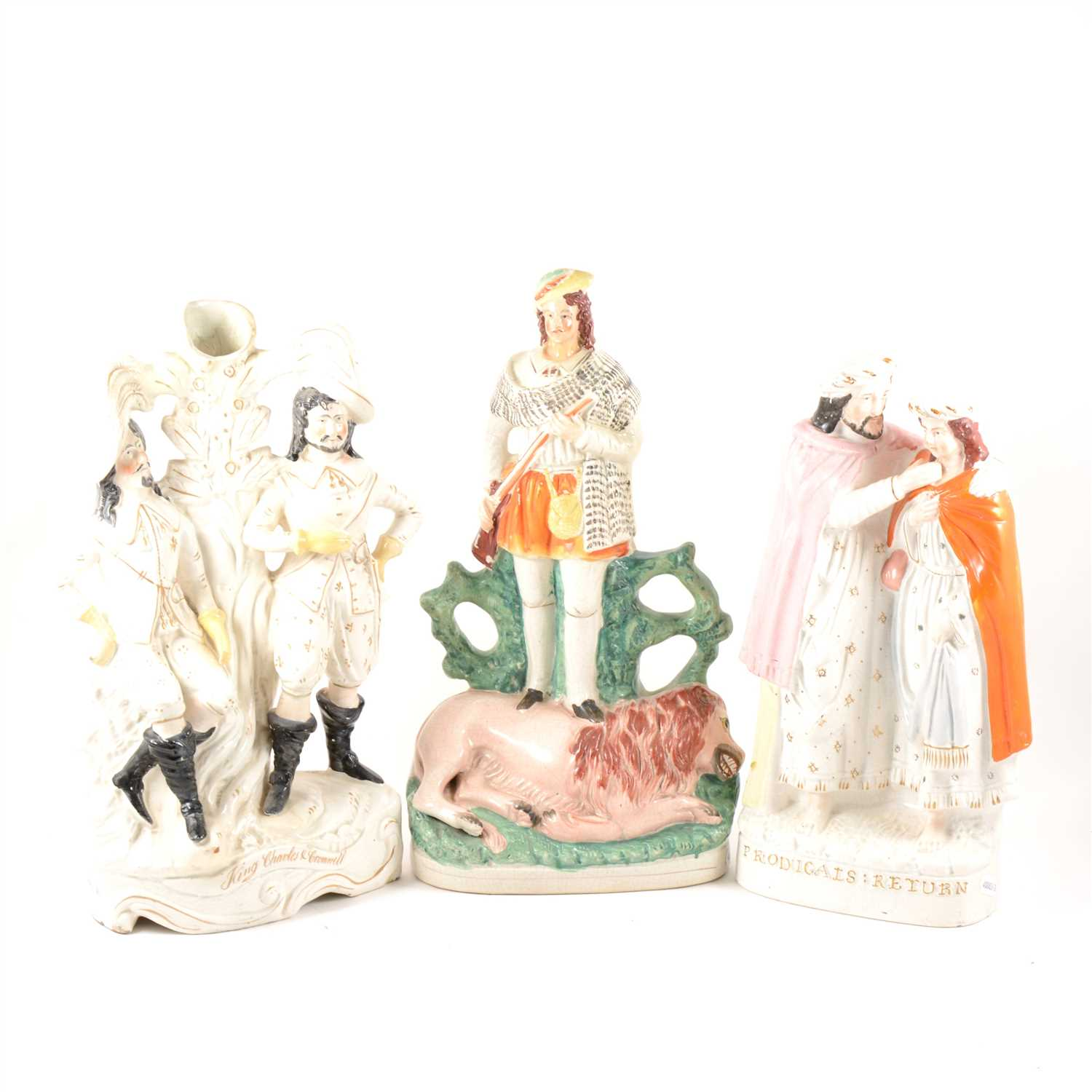 Lot 34-A Staffordshire group, Prodigals Return, and six other Staffordshire figures.