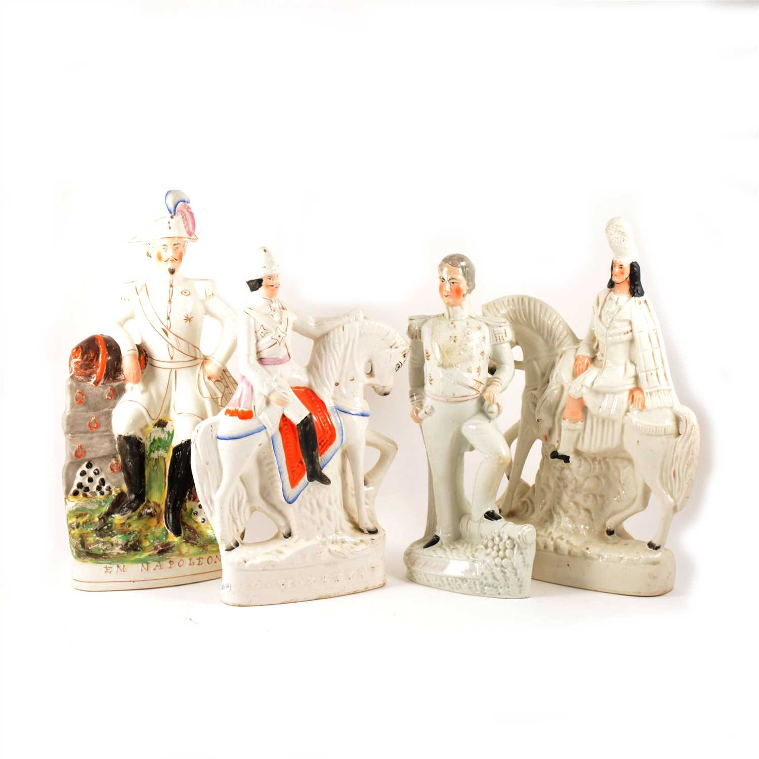 Lot 31-A Staffordshire figure, Emperor Napoleon, and four other Staffordshire figures.