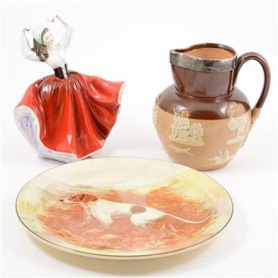 Lot 36-Royal Doulton stoneware jug, with a silver rim; three Royal Doulton Series Ware wall plates.; Doulton figure, Karen