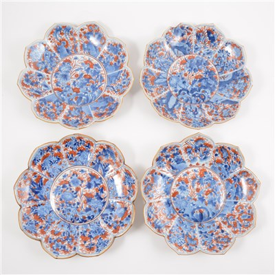 Lot 34-Four Imari shallow bowls, lotus leaf shape, decorated in blue and iron red.
