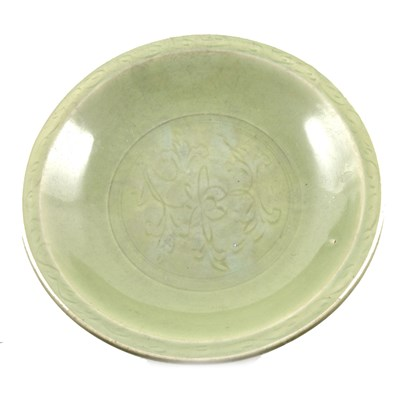 Lot 69-Chinese celadon glazed basin, shallow dished form, incised with lotus flower and scrolls, 20th Century, daimeter 45cm.
