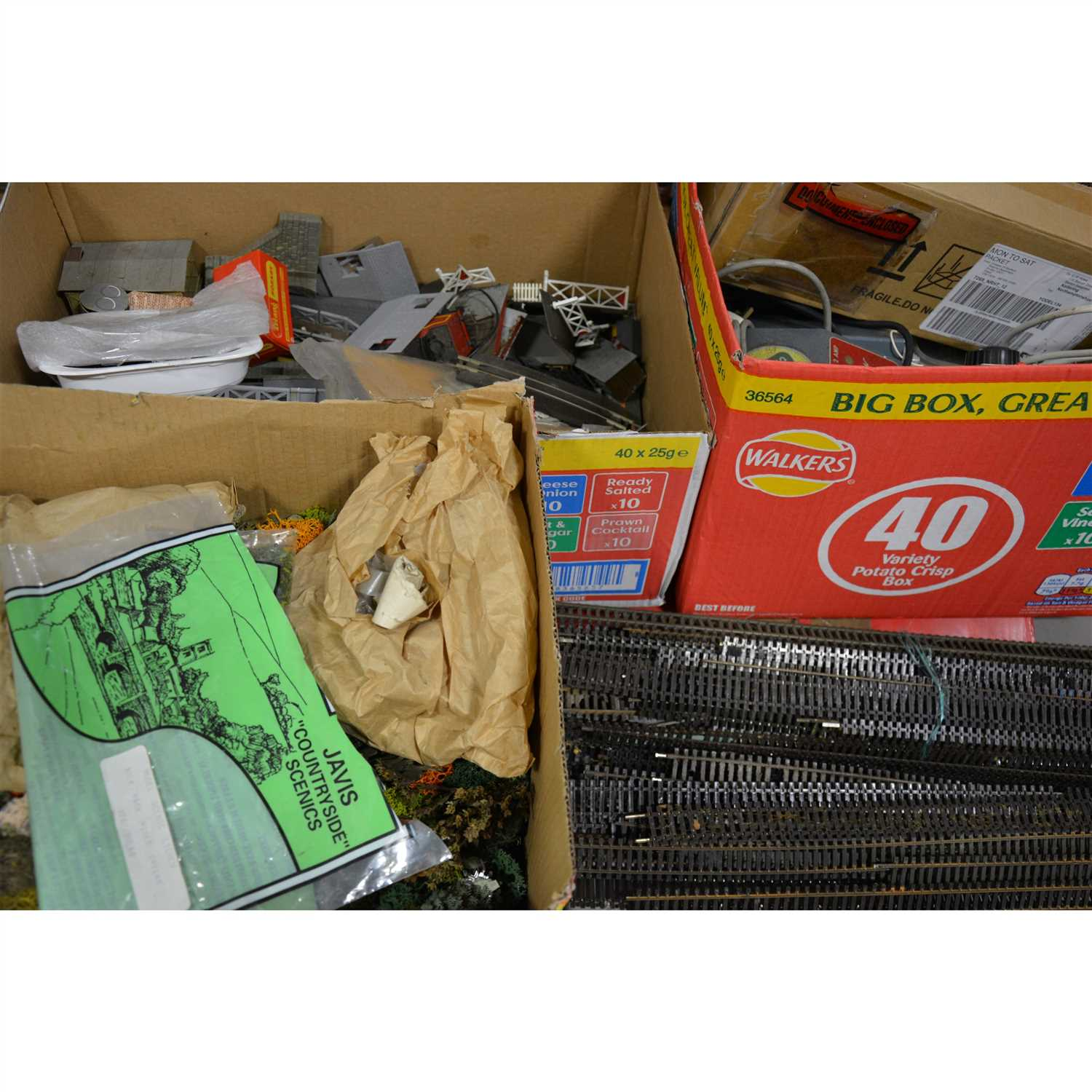 Lot 23-Model railway accessories, card buildings, controllers and track, quantity in five boxes.