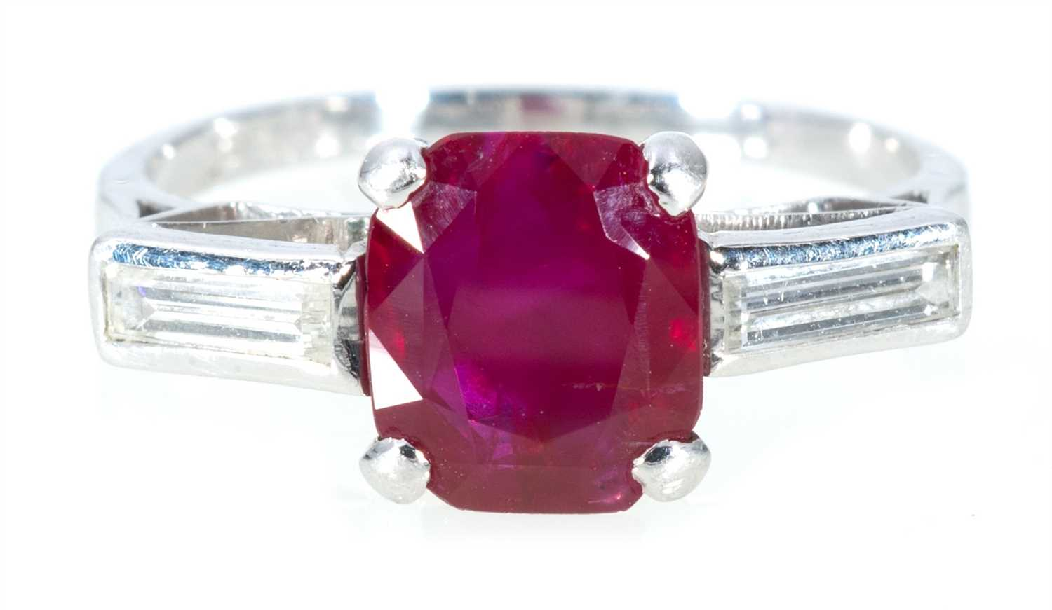 Lot 202-A ruby and diamond three stone ring.