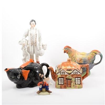 Lot 52-Five novelty teapots, three Staffordshire figures, Beswick Goofy figure, etc.
