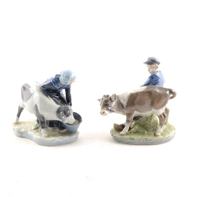 Lot 40-Pair of Royal Copenhagen porcelain models, Boy with Calf, and Girl with Calf