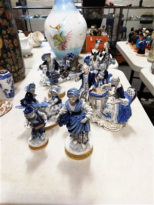 Lot 31-Dresden style porcelain figures, including coaches and horses, pair playing chess, courting couples, etc, (8)
