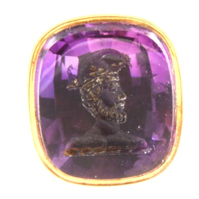 Lot 282-A yellow metal seal with intaglio carved amethyst to base depicting a jester.