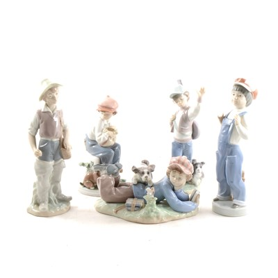 Lot 30-Five Lladro boyhood figures.