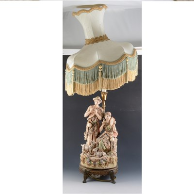 Lot 59-Royal Dux table lamp, modelled with shepherd and shepherdess musicians